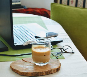 An image of a computer and a coffee